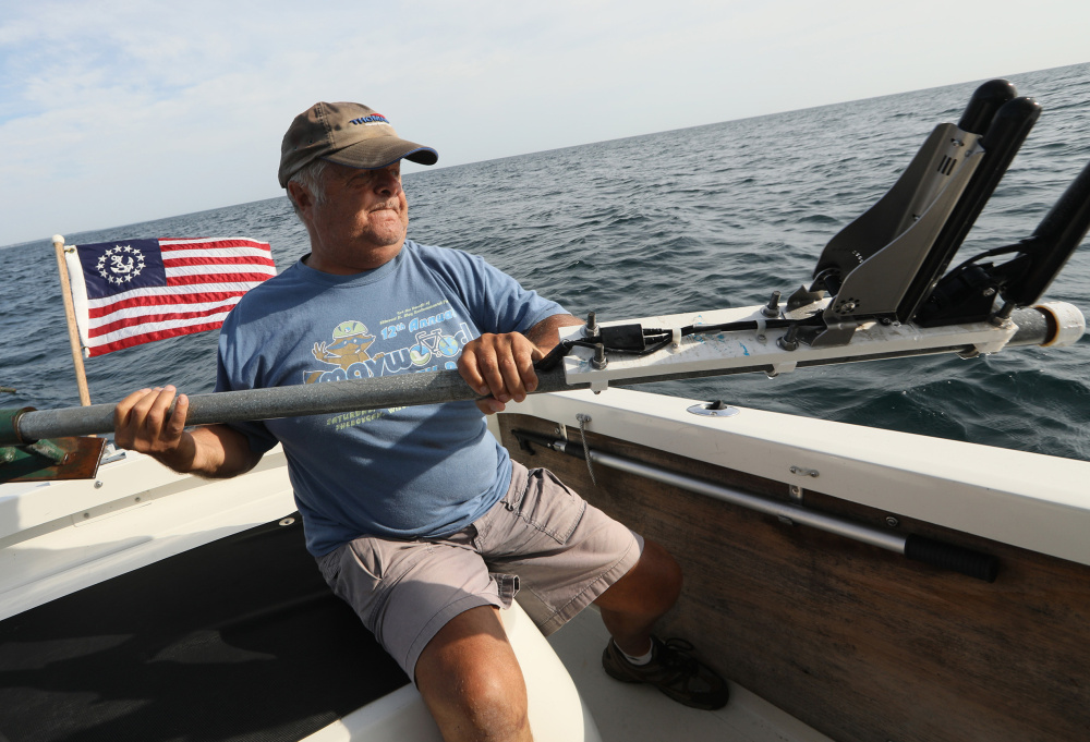 Shipwreck enthusiast Steve Radovan, of Sheboygan, Wis., stows a sonar transducer on his boat Wednesday, Aug. 9, 2017 in Lake Michigan. An avid underwater explorer since the mid-1970's and discoverer of sunken ships, Radovan is a strong advocate for a proposed national marine sanctuary for Lake Michigan. (Chris Walker/Chicago Tribune/TNS)