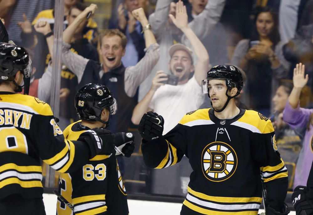 Boston's Kenny Agostino, right, celebrates his game-winning goal with Brad Marchand during overtime of a 2-1 win over Philadelphia on Thursday in Boston.