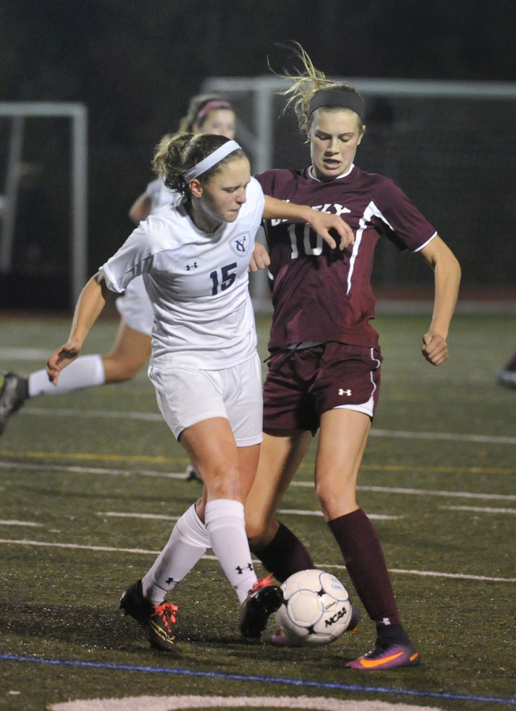 Yarmouth and Greely High soccer players vie for control of the ball during a 2016 game. An ACL injury prevention program that started with Yarmouth's youth and high school girls' soccer teams has been expanded to include all Yarmouth High soccer players.