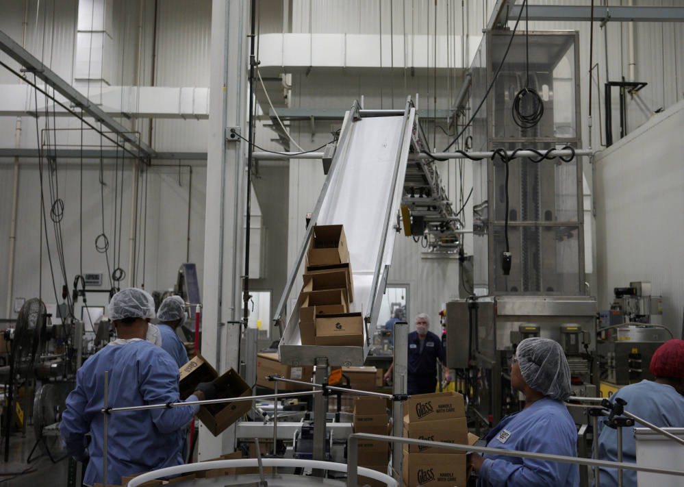 Workers at Tulkoff Food Products in Baltimore, Maryland, prepare products for shipping. Company owner Philip Tulkoff practices zero tolerance for drug use, but it costs him: He has to hire a company to do random drug tests and money is wasted training people who subsequently fail the test. Bloomberg/Associated Press