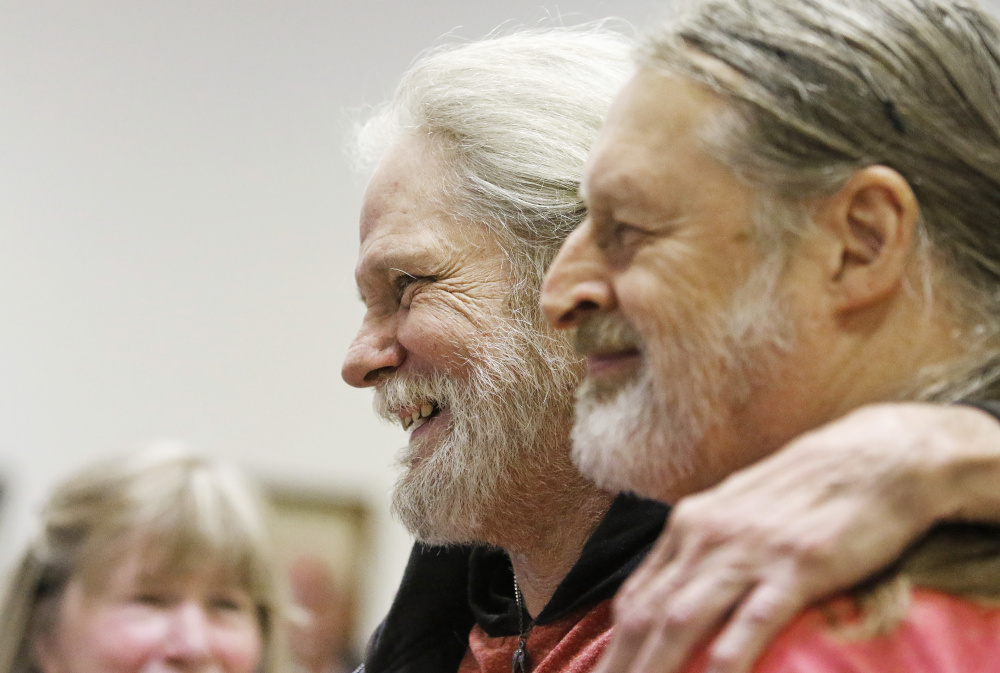 Jack Fogg poses for a photo with Mike Barden during a living wake for Jack, who is dying of liver cancer. (Staff photo by Jill Brady)