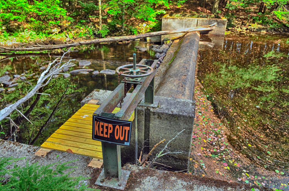 The fish ladder on the far side of the dam at Sheepscot Pond is closed in May and June.