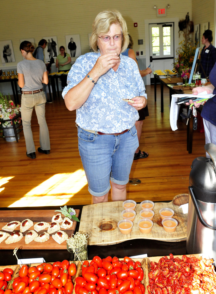 Audrey Bemis of Harmony samples tomato dishes at the Seed to Table Variety Tasting at the Unity Food Hub on Sunday.