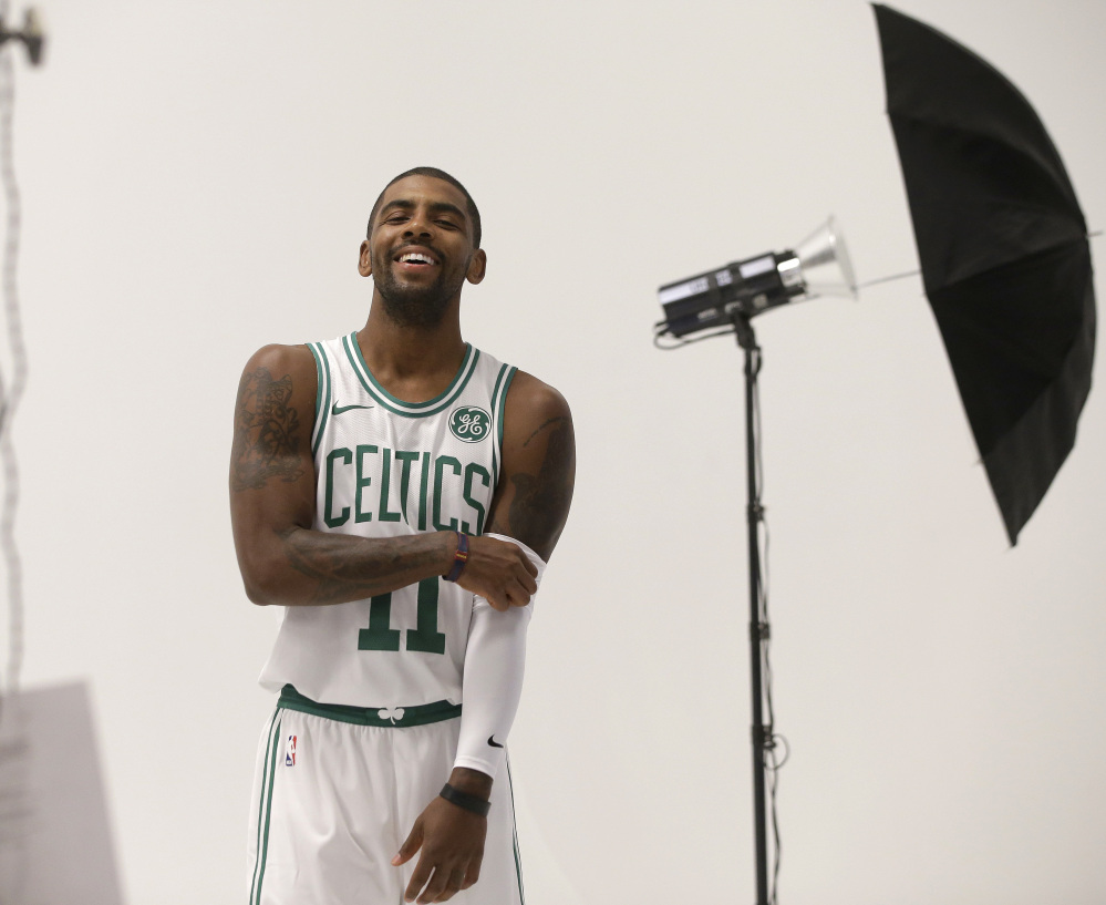 Kyrie Irving smiles during a photo shoot at Celtics media day Monday in Canton, Massachusetts. Irving joins Gordon Hayward as key additions to the Eastern Conference finalists.