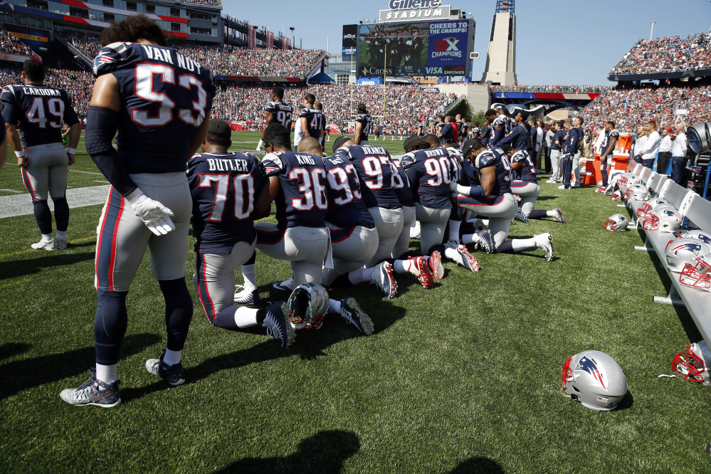 Some of the New England Patriots' players took a knee during the playing of the national anthem Sunday in Foxborough, Mass. – part of protests throughout the NFL.