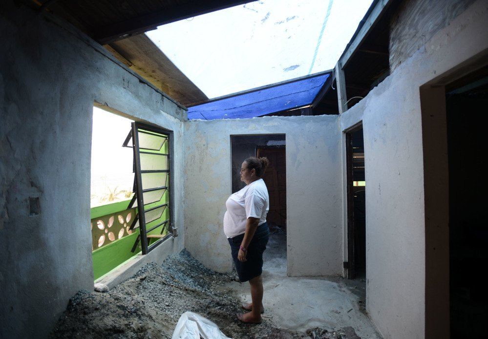 La Perla, Puerto Rico, resident Maritza Rosado stands inside her roofless home Monday. The island territory is reeling in the devastating wake of Hurricane Maria.
