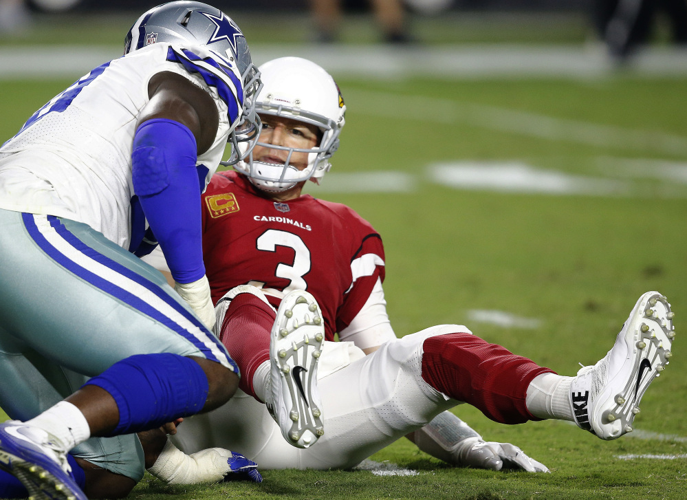 Cardinals quarterback Carson Palmer looks at Dallas defensive end Demarcus Lawrence after being sacked in the second half.