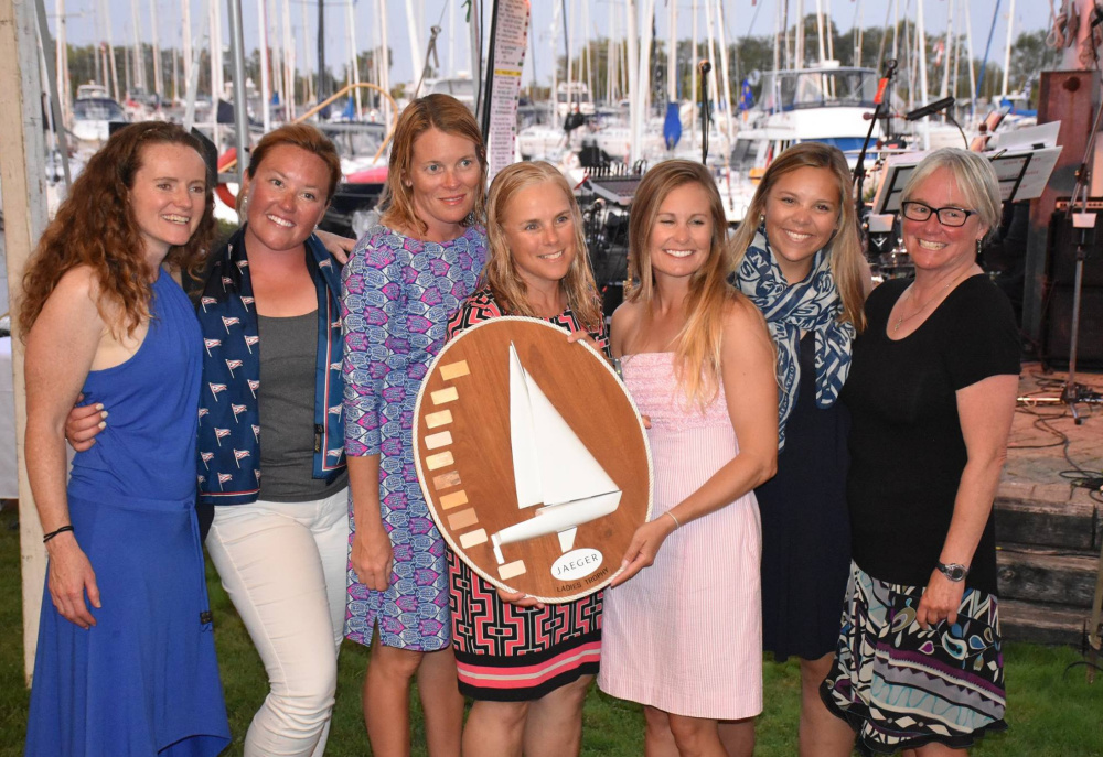 Members of the Sea Bags women's sailing team based in Portland pose with their trophy after placing first among the three all-women's teams at the J/24 world sailing championships last week on Lake Ontario. From left are Jessica Harris, Charlotte Kinkade, Karen Fallon, Erica Beck Spencer, Hillary Noble, Katie Drake and Joy Martin.