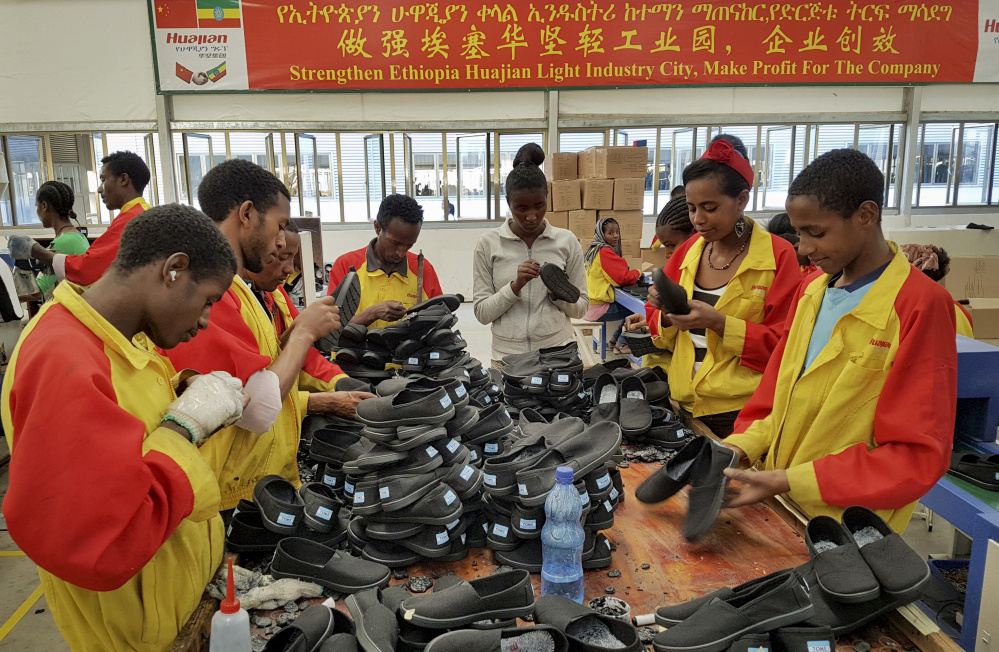Workers sort shoes in January at a Chinese factory in Addis Ababa, Ethiopia.  The
