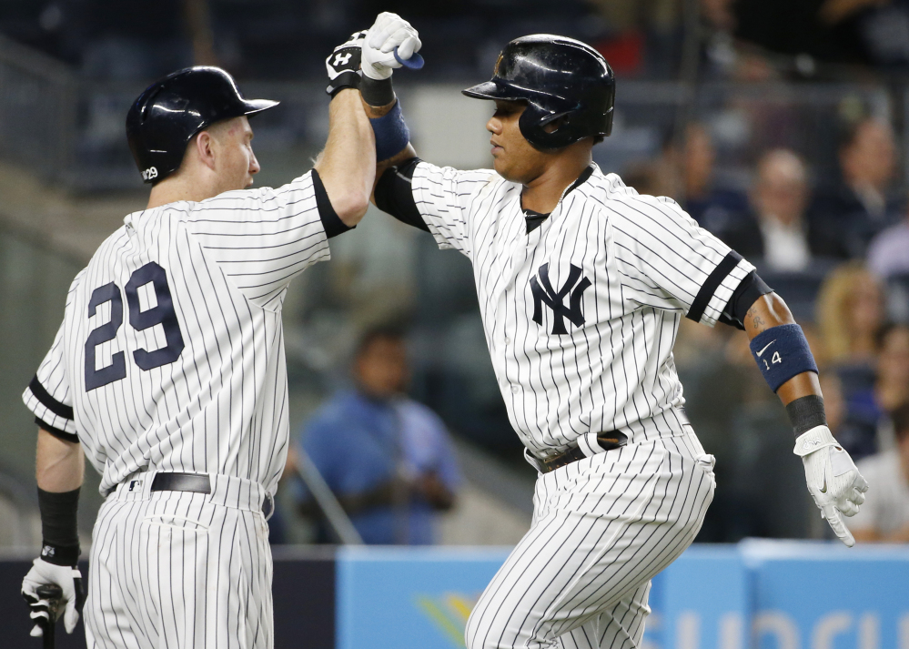 Starlin Castro, right, celebrates his solo home run with on-deck batter Todd Frazier during the second inning of Tuesday's game in New York. The Yankees beat the Rays, 6-1.