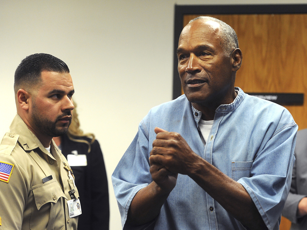 Former pro football star O.J. Simpson reacts after learning he was granted parole this July at Lovelock Correctional Center in Lovelock, Nev.