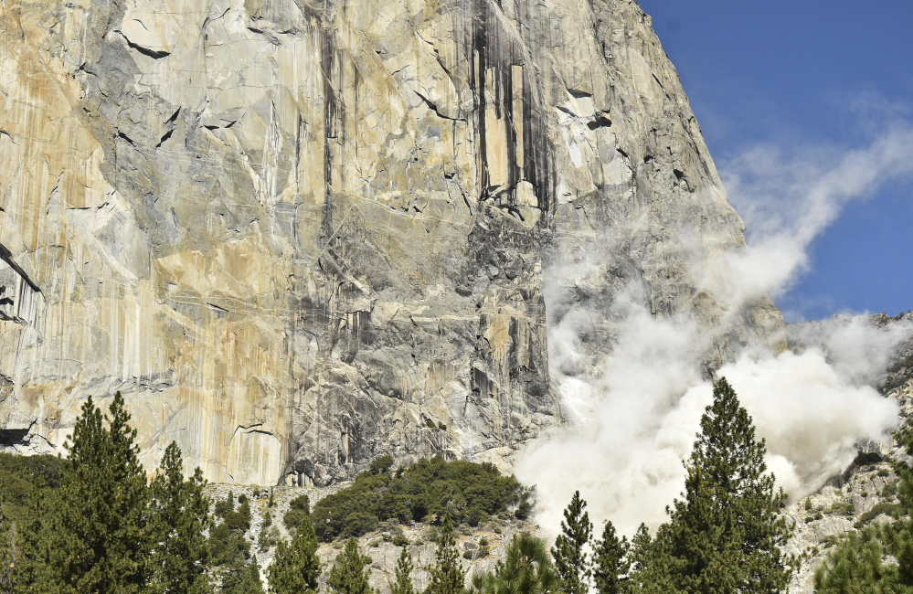 A cloud of dust rises Wednesday after a rock fall at El Capitan in Yosemite National Park, Calif. An official said one British climber was killed and another was seriously injured.
