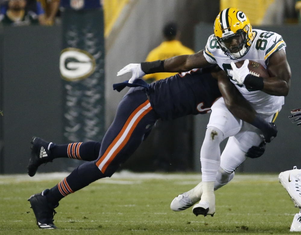 Green Bay's Ty Montgomery is hit by Chicago's Leonard Floyd in the first half Thursday night in Green Bay. Montgomery left the game in the first quarter with a chest injury.