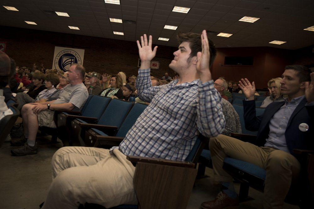 Ryan Murphy of Portland shows his agreement by waving his hands during a Democratic gubernatorial candidates' forum Thursday night at the University of Maine at Augusta. The event was hosted by the Kennebec County Democratic Party.
