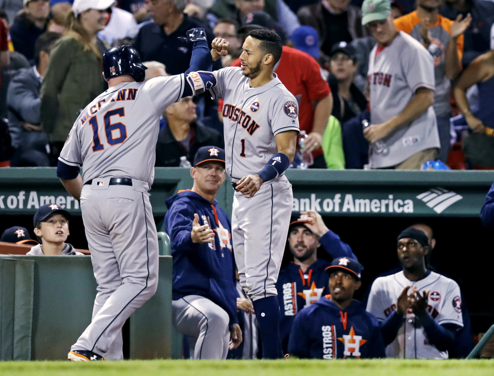 Houston's Brian McCann is congratulated by Carlos Correa after his solo home run off Red Sox reliever Austin Maddox in the sixth inning Thursday night at Fenway Park.