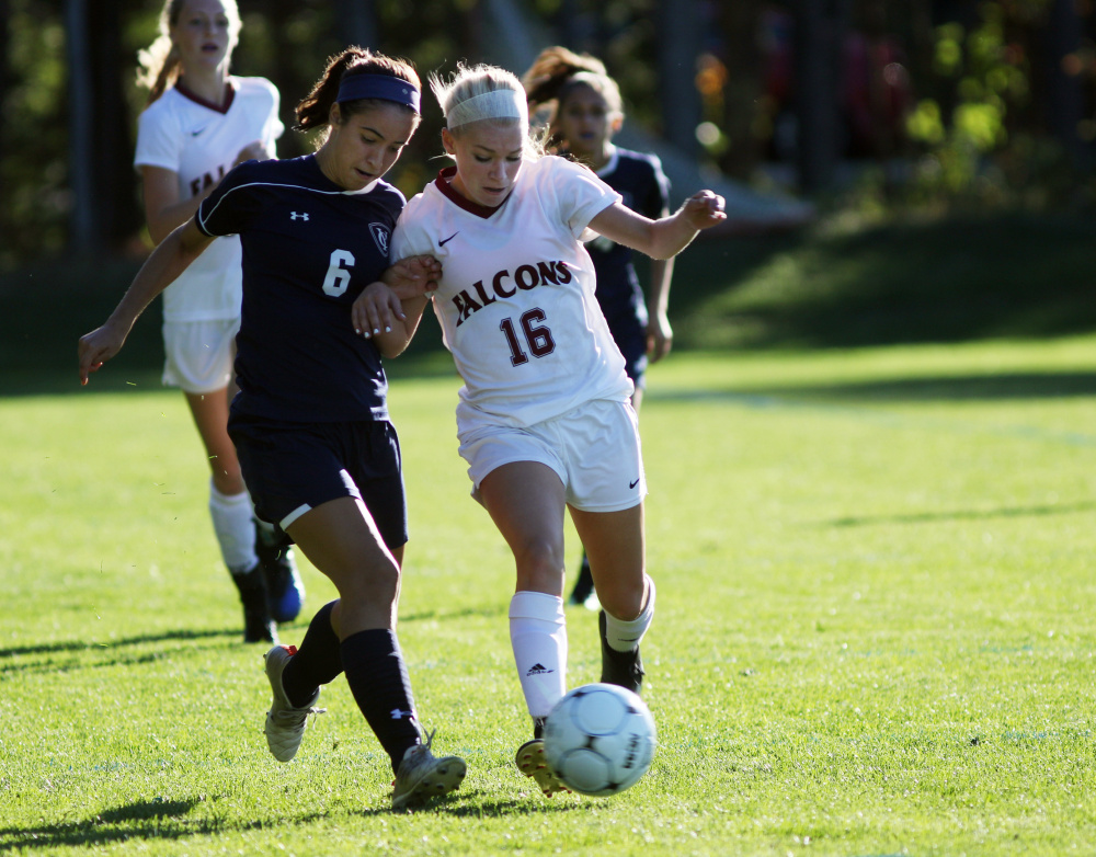 Sophia Harpool of Yarmouth, left, and Tara Migliaccio of Freeport compete for the ball. Yarmouth improved its record to 10-0 and dropped the Falcons to 6-3.