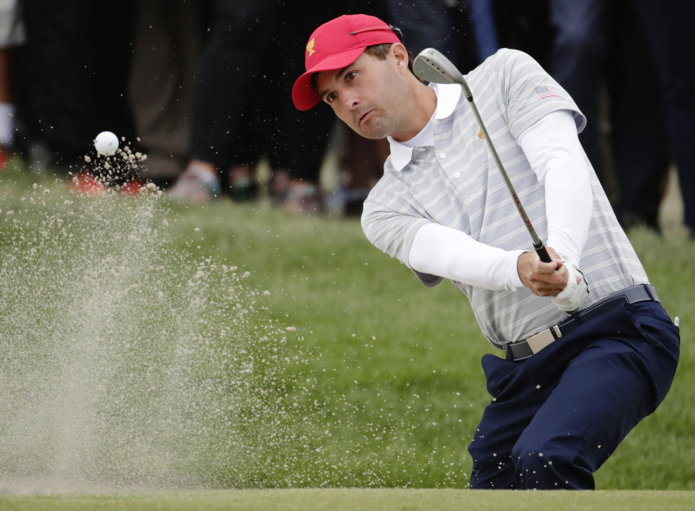 Kevin Kisner hits out of a bunker on the 16th hole on Saturday during the third day of the Presidents Cup at Liberty National Golf Club in Jersey City, N.J. The United States team needs just one point out of Sunday's 12 matches to clinch the Cup