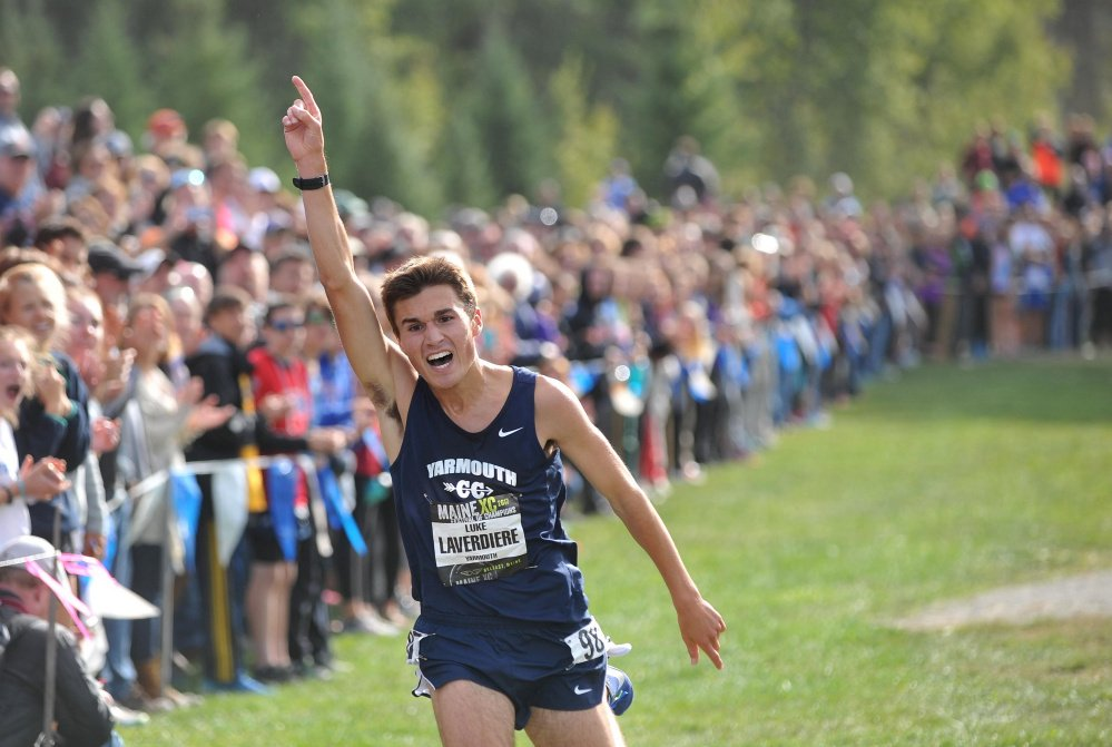 Yarmouth High senior Luke Laverdiere celebrates his first-place finish a the tMaine XC Festival of Champions in Belfast on Saturday.  Laverdiere was just four seconds off the course record. (Staff photo by Michael G. Seamans)
