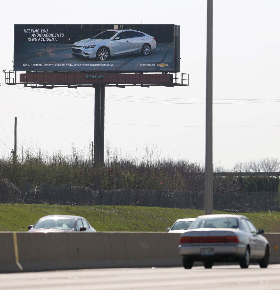 An interactive billboard on Interstate 88 near Eola Road in Aurora, Ill., touts the virtues of the Chevrolet Malibu. The sign uses vehicle recognition technology to identify competing sedans and display ads aimed at their drivers.