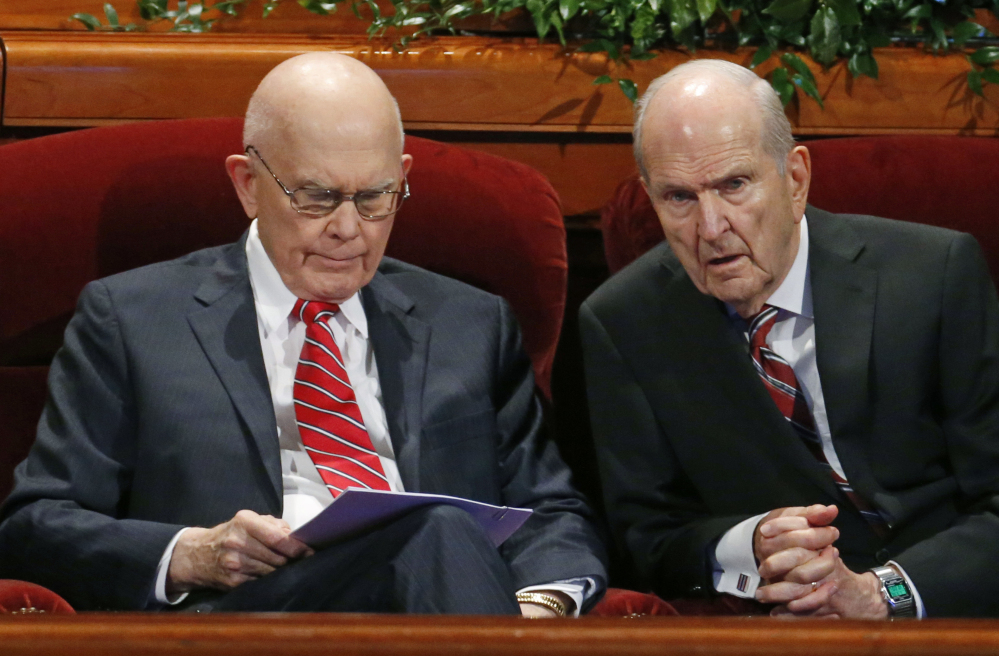 Dallin H. Oaks, left, and  Russell M. Nelson, members of the Twelve Apostles of The Church of Jesus Christ of Latter-day Saints, speak Saturday at the two-day conference.