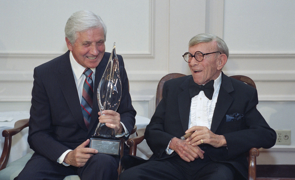 Monty Hall, left, recipient of the second George Burns Lifetime Award, laughs with George Burns at the United Jewish Fund tribute to Hall in 1993 in Los Angeles.