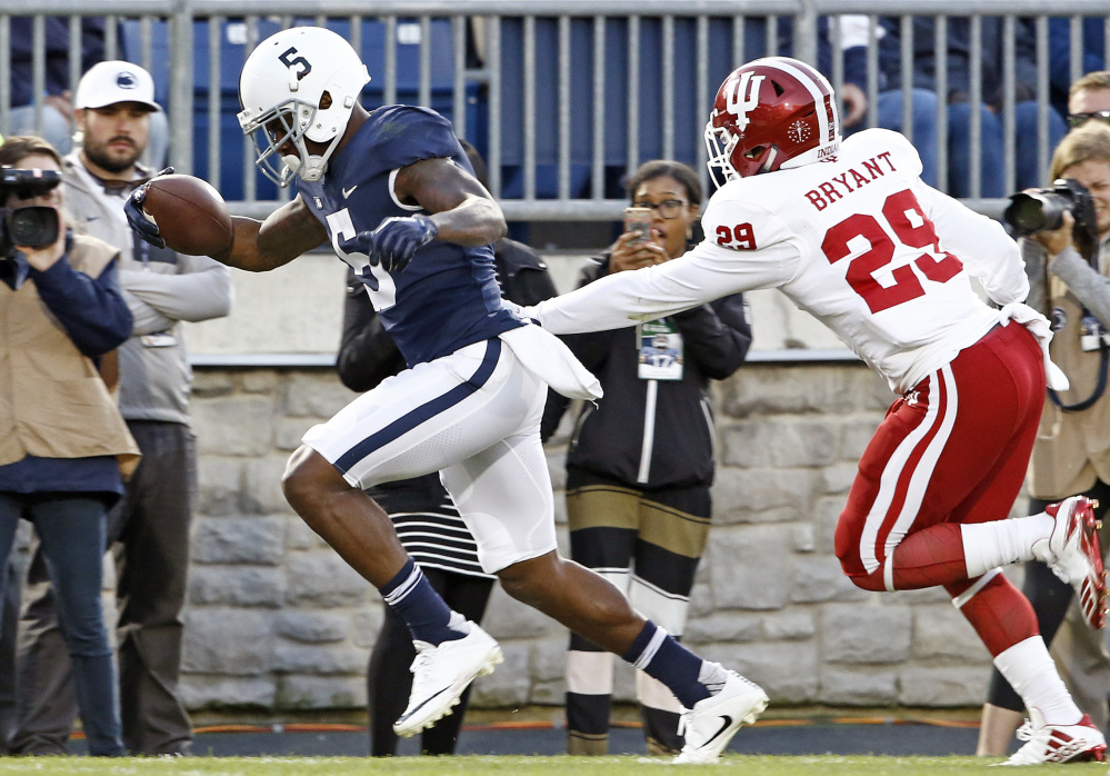 Penn State's DaeSean Hamilton scores one of his three receiving touchdowns, beating Indiana's Khalil Bryant into the end zone during the Nittany Lions' 45-14 win Saturday in State College, Pennsylvania. Hamilton had nine receptions.