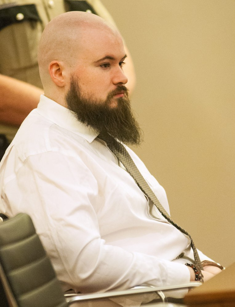 Leroy Smith III sits in a courtroom at Capital Judicial Center in Augusta on Jan. 20 during a hearing on his mental competence to be tried for murder in connection with the slaying and dismembering of his father in May 2014. Smith is scheduled to stand trial on Monday after pleading not criminally responsible to the killing.