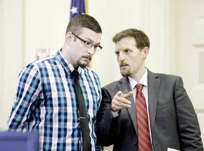 Timothy Danforth, left, talks with his co-counsel, Jeffrey Wilson, before the start of Danforth's murder trial in Franklin County Superior Court on Monday.