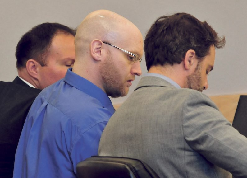 Defendant Robert Burton, center, and his defense team of attorneys Zachary Brandmeir, left, and Hunter Tzovarras listen on Monday in Penobscot Superior Court in Bangor during opening statements in his murder trial in connection with the death of Stephanie Gebo. Testimony is scheduled to continue Wednesday.