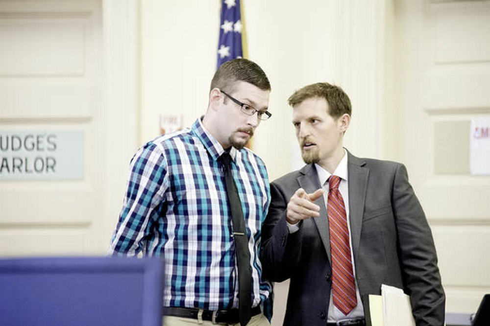 Timothy Danforth, left, talks with his co-counsel, Jeffrey Wilson, on Monday before the start of Danforth's murder trial in Franklin County Superior Court.