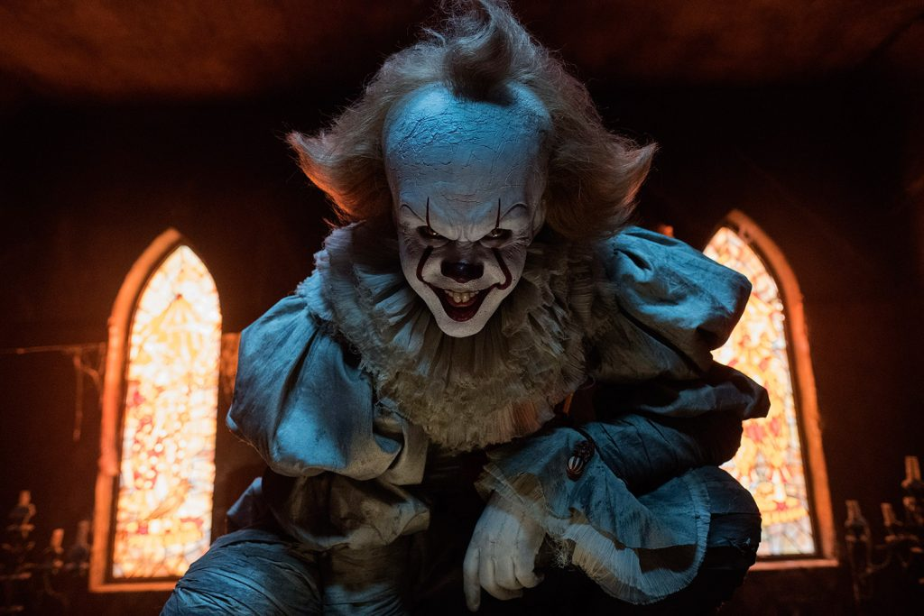 "Bill Skarsgard plays the terrifying clown Pennywise in a scene from ""It."" He'll reprise the role in the sequel, due out in September 2019."