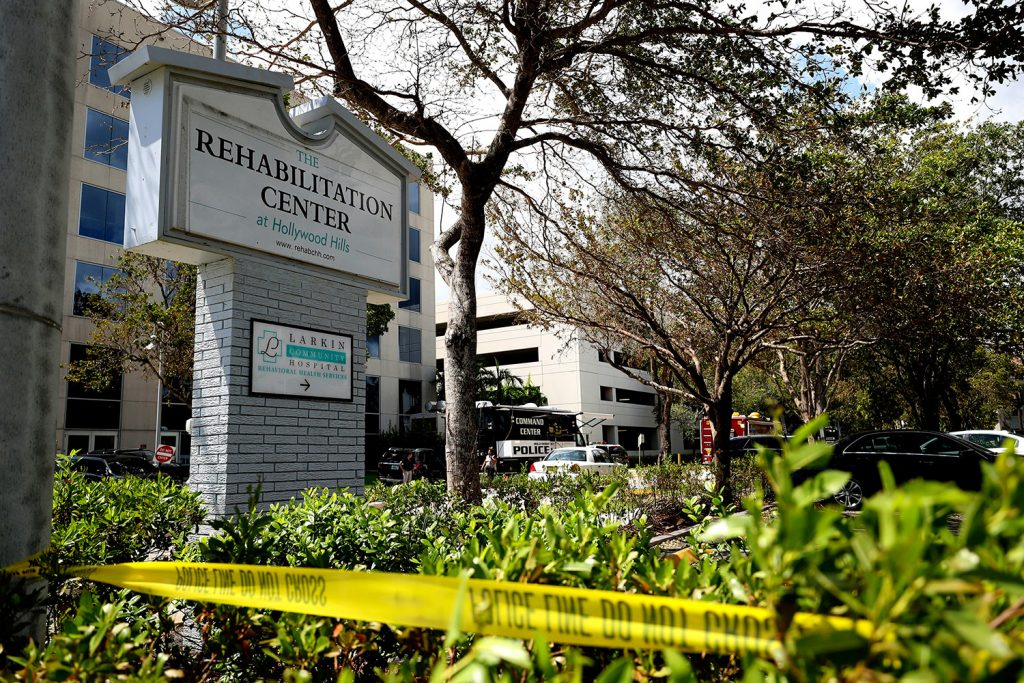 Police tape surrounds the Rehabilitation Center in Hollywood Hills, Fla., which had no air conditioning after Hurricane Irma knocked out power. Eight patients at the sweltering nursing home died, and investigators are trying to determine how conditions deteriorated so quickly.