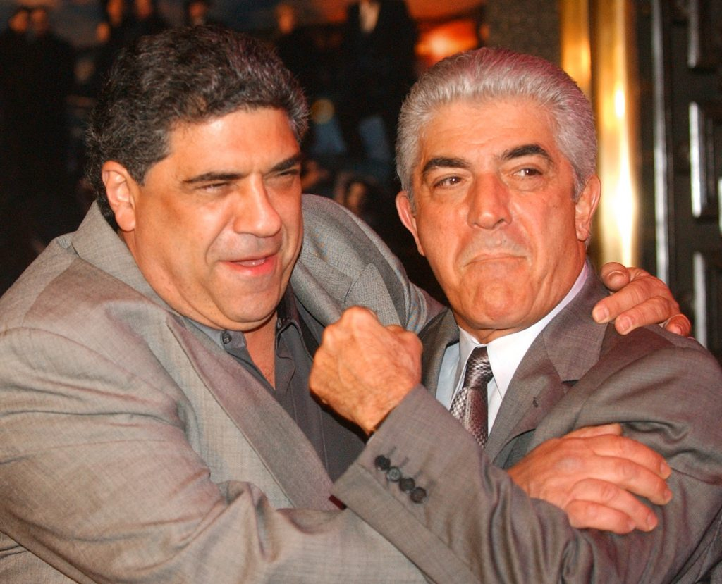 "In this March 2, 2004 photo, actors Vincent Pastore, left, and Frank Vincent rough around for photographers at the fifth season premiere of the HBO series ""The Sopranos,"" at New York's Radio City Music Hall. Vincent, a veteran character actor who often played tough guys, including mob boss Phil Leotardo on ""The Sopranos,"" has died. He was 80."