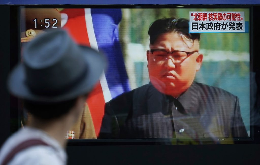 A man in Tokyo watches a news program on a public screen showing North Korean leader Kim Jong Un on Sept. 3, the day of a nuclear test by North Korea. Early Friday, North Korea launched another missile over Japan.