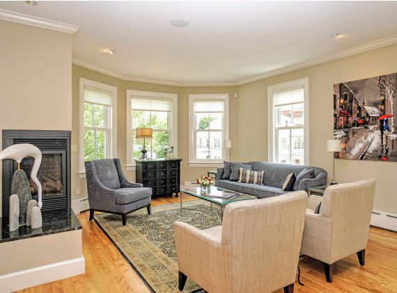 The living room, with corner gas fireplace. Photo by Diane Maines.
