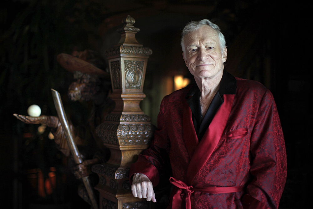 Hugh Hefner poses for a portrait at his Playboy mansion in Los Angeles in 2010.