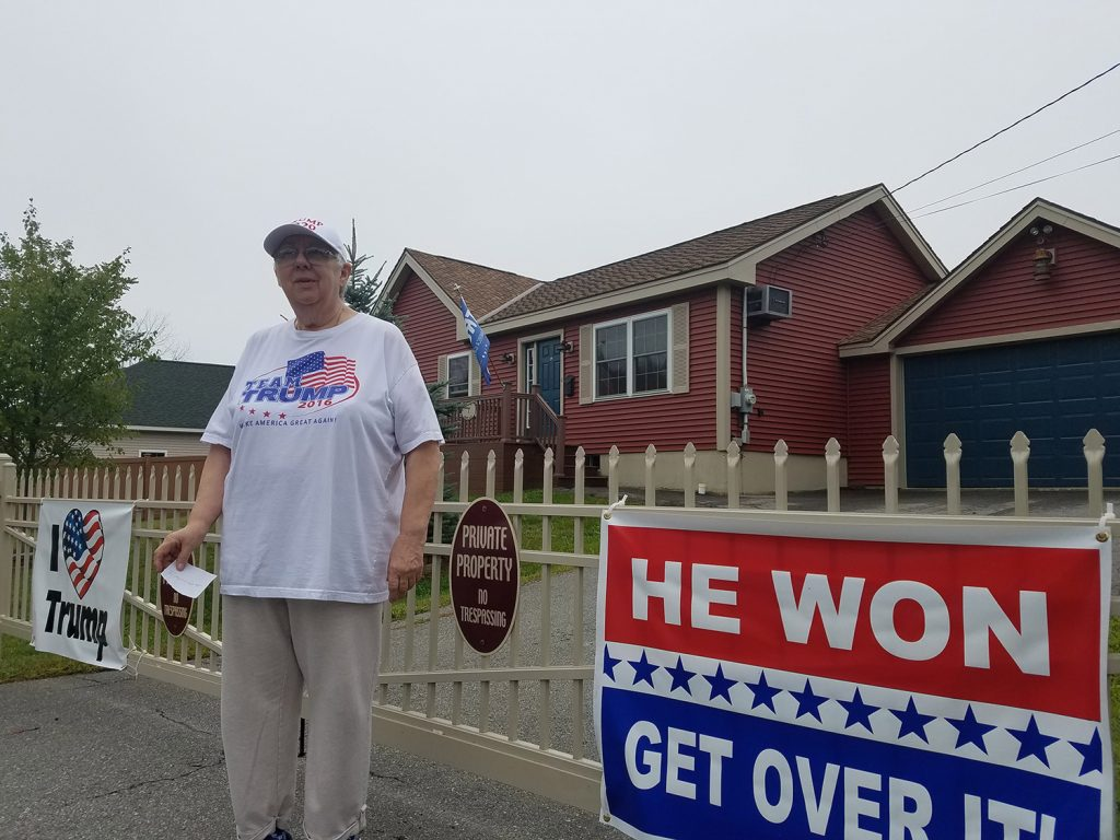 Susan Reitman of Seavey Lane in Rockland has said she won't take down the signs on her property and won't pay a fine for allegedly violating a town ordinance regarding the size and number of signs on private property.
