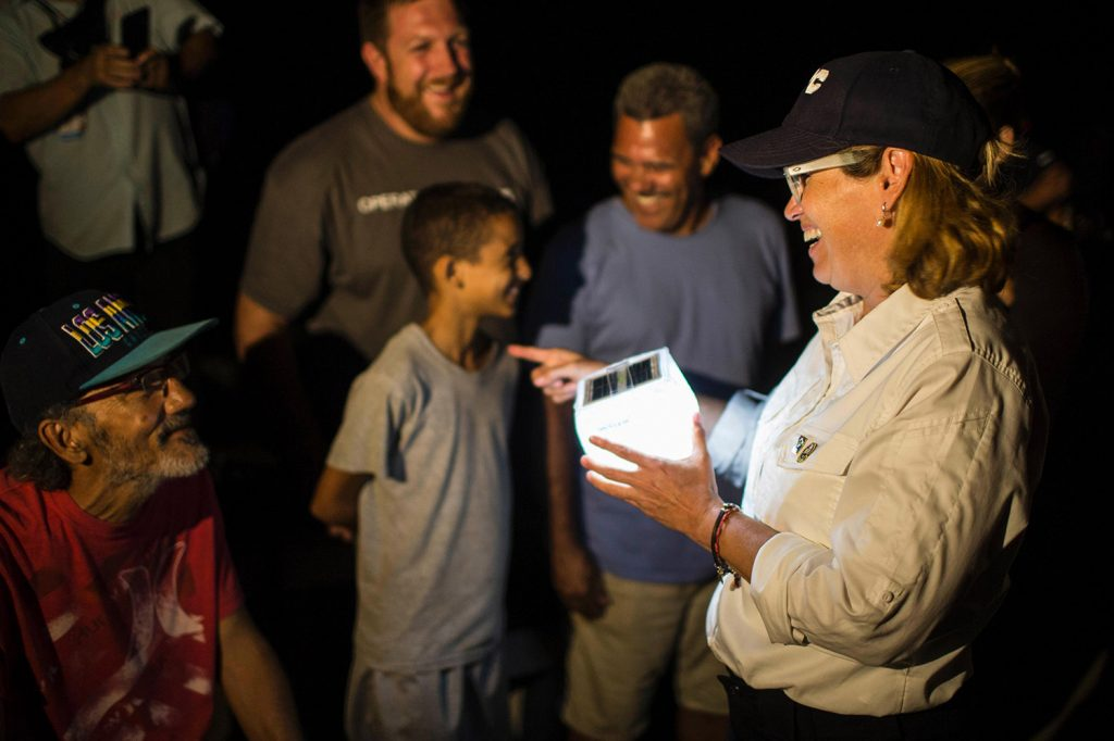 San Juan Mayor Carmen YulÌn Cruz distributes solar lamps in the city's La Perla neighborhood. Cruz issued emotional pleas Friday for the federal government to step up hurricane relief efforts in Puerto Rico.