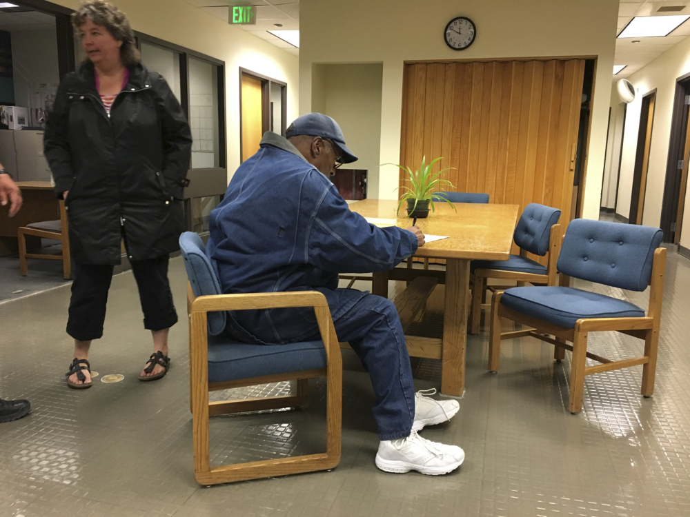 Former football legend O.J. Simpson signs documents at the Lovelock Correctional Center late Saturday. Simpson was released from the correctional center in northern Nevada early Sunday.