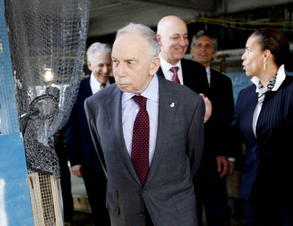 Conde Nast chairman S.I. Newhouse Jr. leaves a news conference in New York in 2011. The billionaire media mogul died at his New York home Sunday. He was 89.