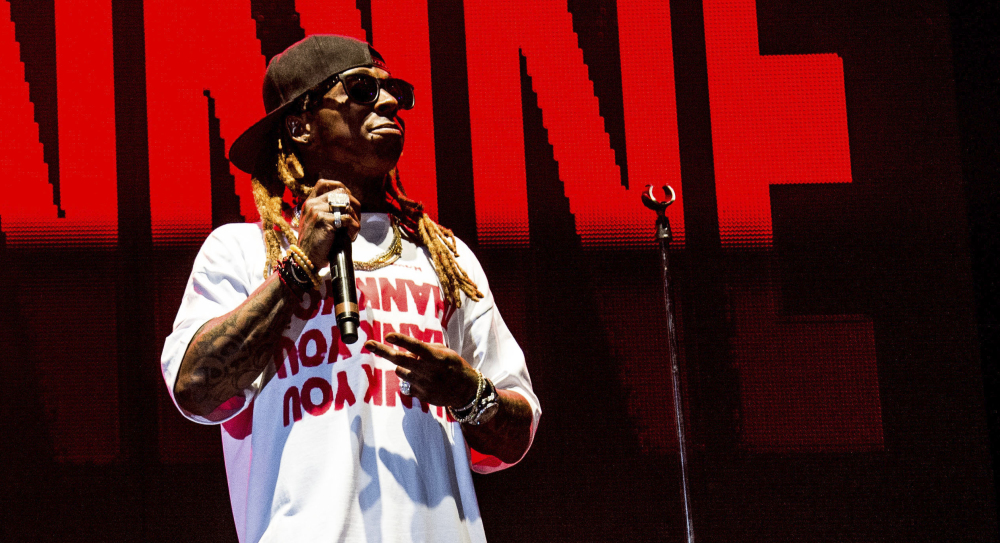 Lil Wayne, whose real name is Dwayne Michael Carter Jr., performs at a concert in New Orleans.
