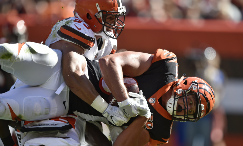 Cincinnati tight end Tyler Kroft is hit by Cleveland outside linebacker Joe Schobert but not before scoring on a 16-yard touchdown pass in the Bengals' 31-7 win Sunday in Cleveland.