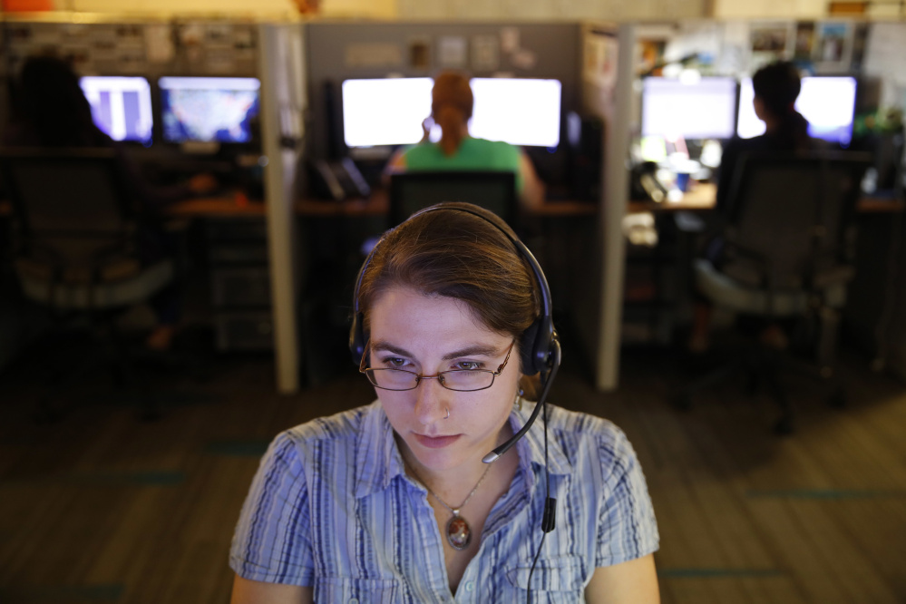 An advocate takes a call from a potential victim of trafficking while working at the Human Trafficking Hotline call center.