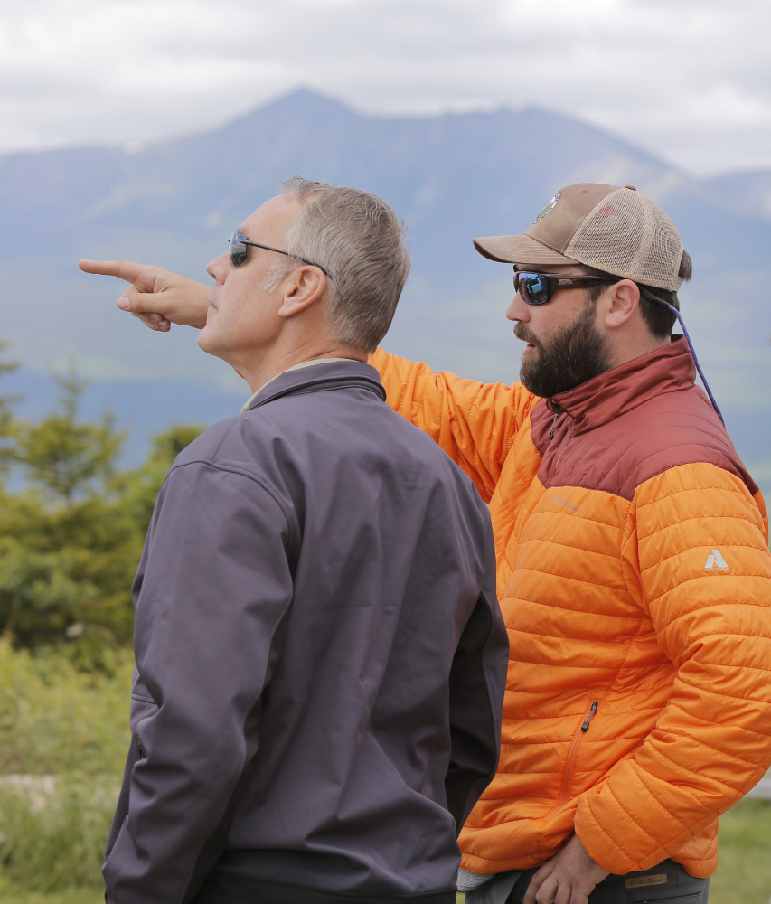 KATAHDIN WOODS AND WATERS NATIONAL MONUMENT, ME - JUNE 14: With Mount Katahdin in the background, Lucas St. Clair, right, points out features in the landscape to Interior Secretary Ryan Zinke, during a tour of the Katahdin Woods & Waters National Monument on Wednesday, June 14, 2017. Zinke was touring the monument because it is one of dozens of monuments up for review under an executive order from President Trump. St. Clair's family donated the land for the monument to the National Park Service last year.