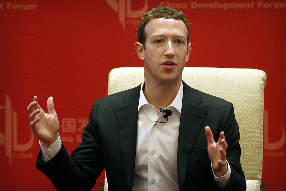 Facebook CEO Mark Zuckerberg speaks during a panel discussion in Beijing.