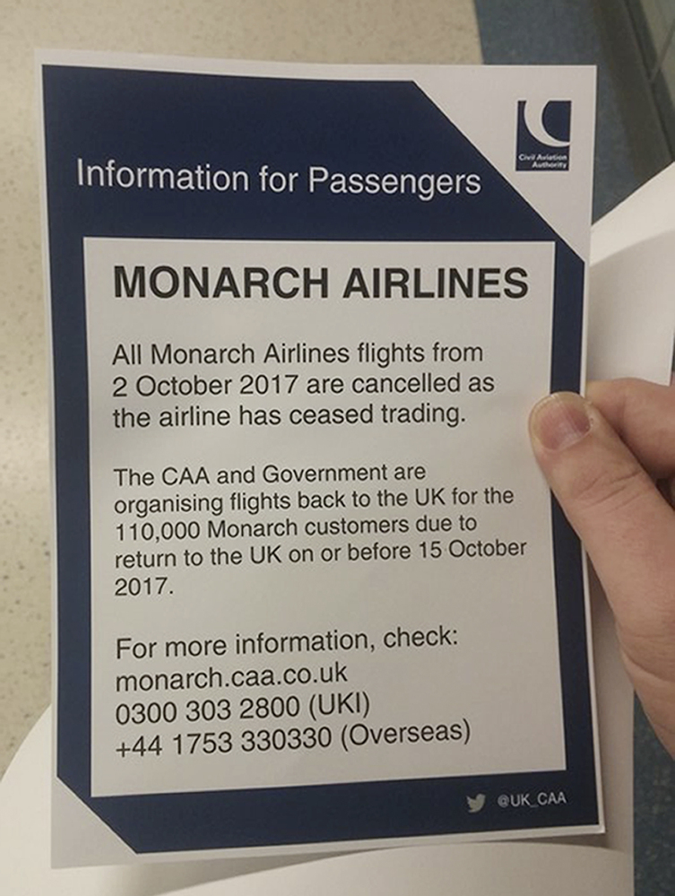 A notice for troubled British carrier Monarch Airlines passengers is seen at London's Gatwick Airport on Monday. Monarch Airlines has suspended all flights.