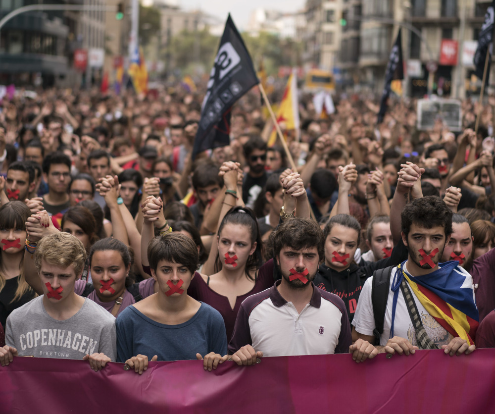 Independence supporters march in Barcelona on Monday. The Spanish government has praised its security forces' actions, including shooting rubber bullets, during Sunday's voting.