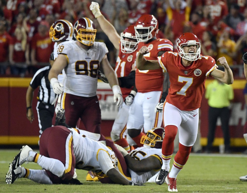 Harrison Butker, right, celebrates Monday night after kicking a go-ahead field goal with eight seconds left that paved the way for a 29-20 victory against Washington, making the Kansas City Chiefs the final undefeated team in the NFL.