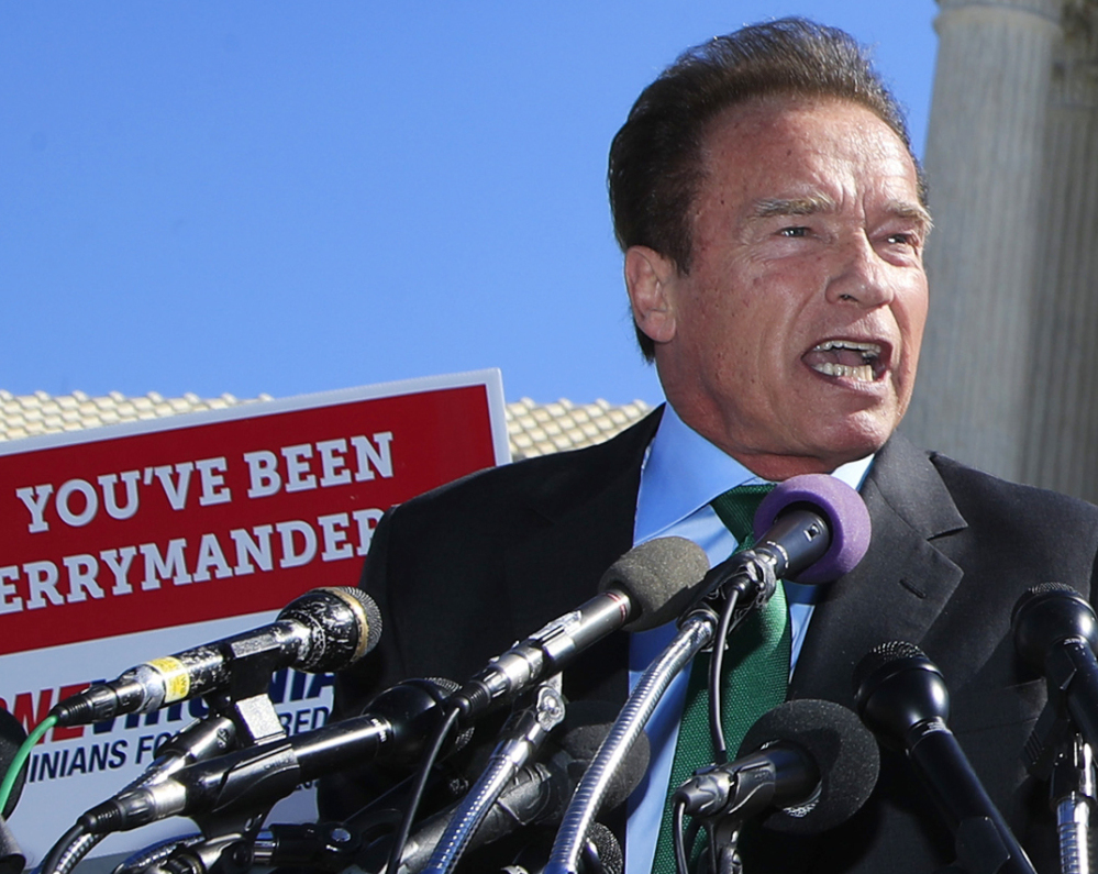 Former California Gov. Arnold Schwarzenegger was one of several speakers at a rally outside the Supreme Court on Tuesday in support of limits on political districts.