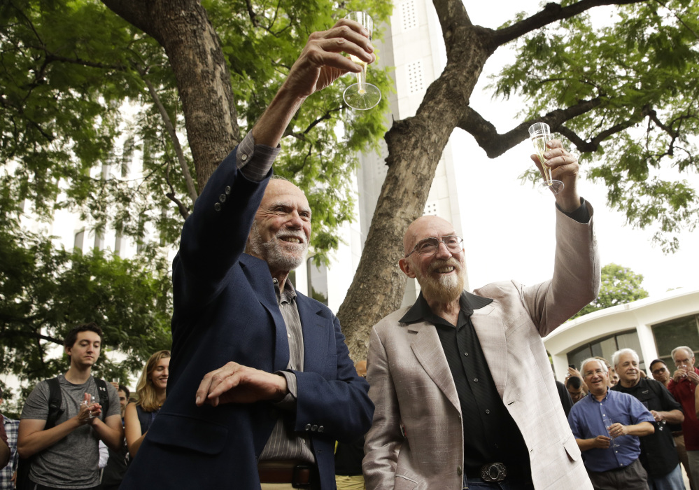 Barry Barish, left, and Kip Thorne, both of the California Institute of Technology, share a toast Tuesday to celebrate winning the Nobel Prize in Physics.